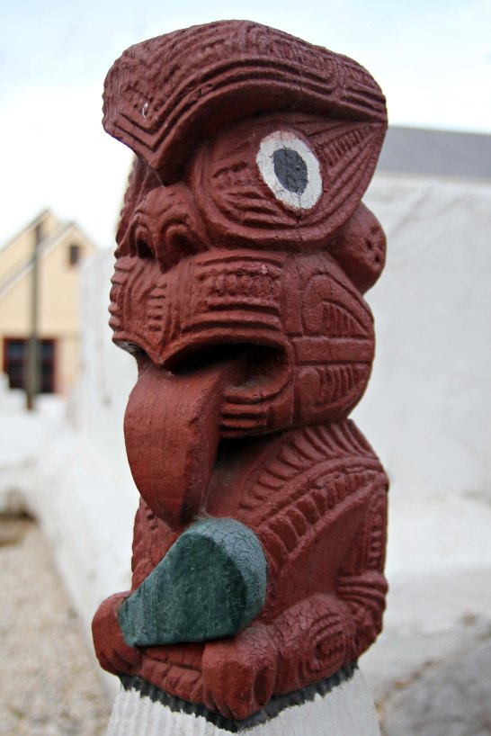 Maori sculpture depicting a warrior from the village