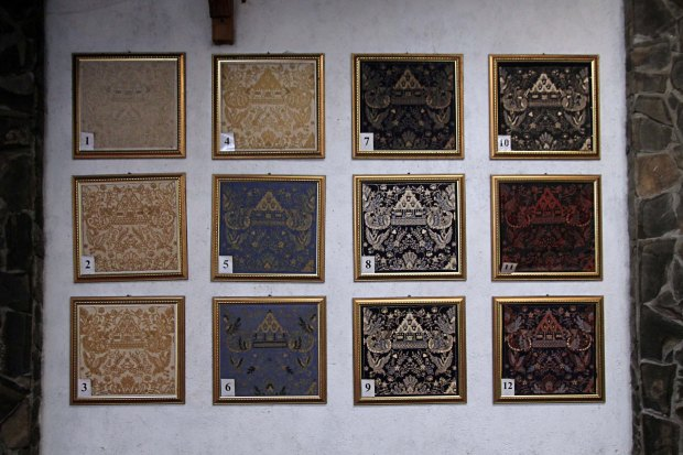The many stages of a three coloured batik painting