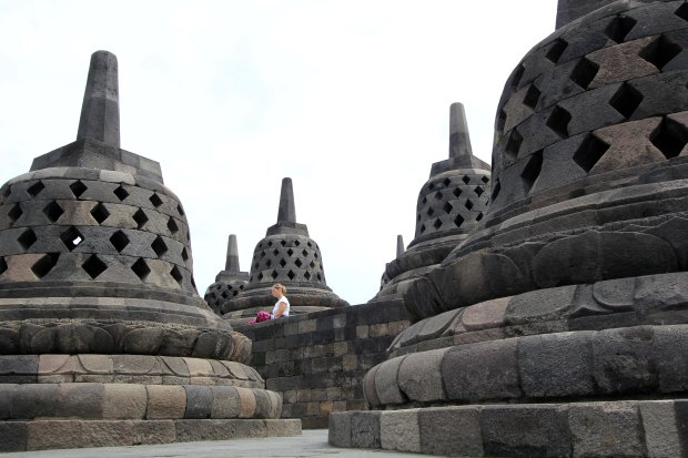 Stupas and woman meditating
