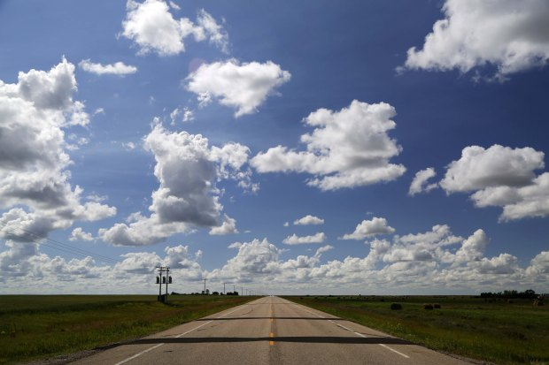 Prairie clouds, prairie road